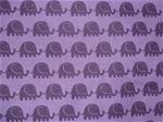 Lila bomullstyg med mörklila elefanter