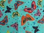 Ljusblått bomullstyg med fjärilar