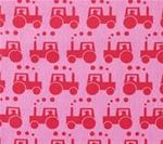 Rosa bomullstyg med röda traktorer