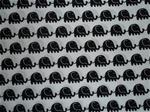 Vitt bomullstyg med svarta elefanter